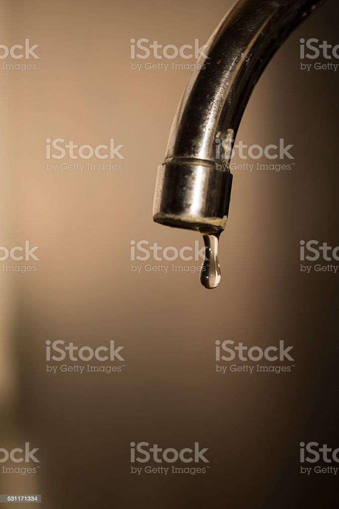 photo of a faucet head leaking stock photo
