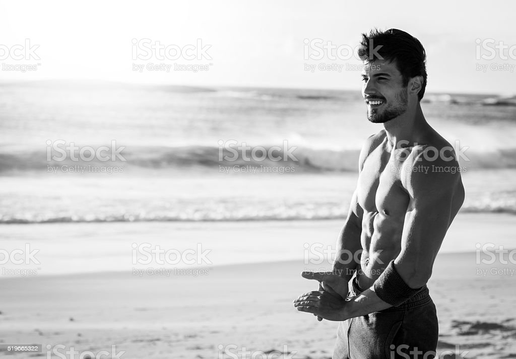 photo of a fit man enjoying the break after workout stock photo