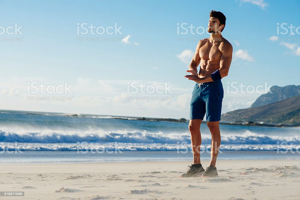 photo of a fit man takin a break from jogging stock photo