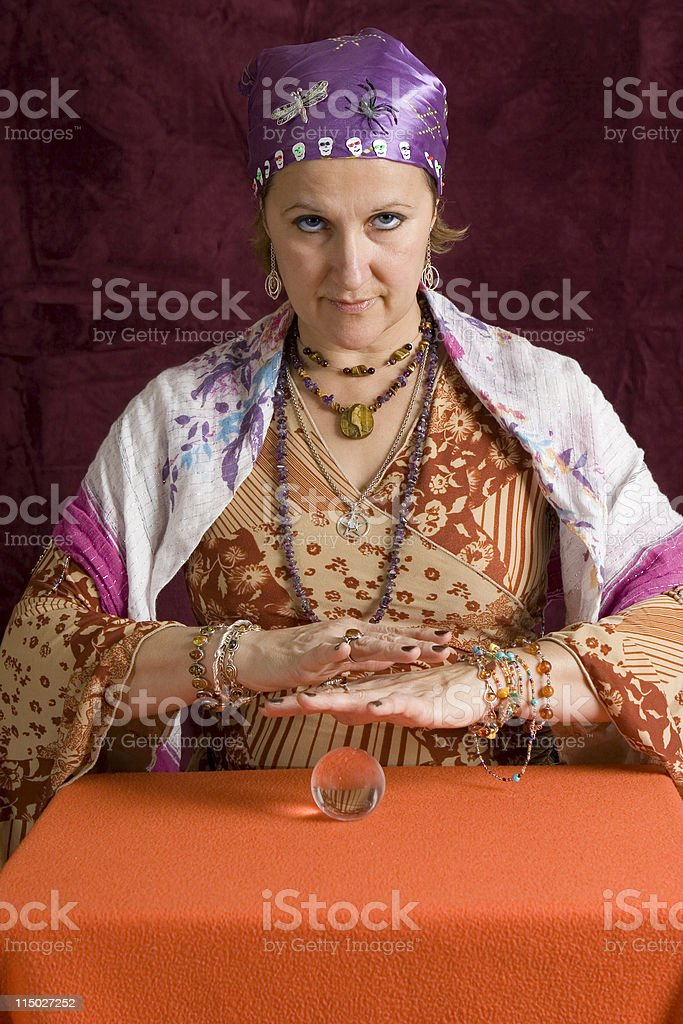 Photo of a fortune teller, in costume, with a crystal ball stock photo