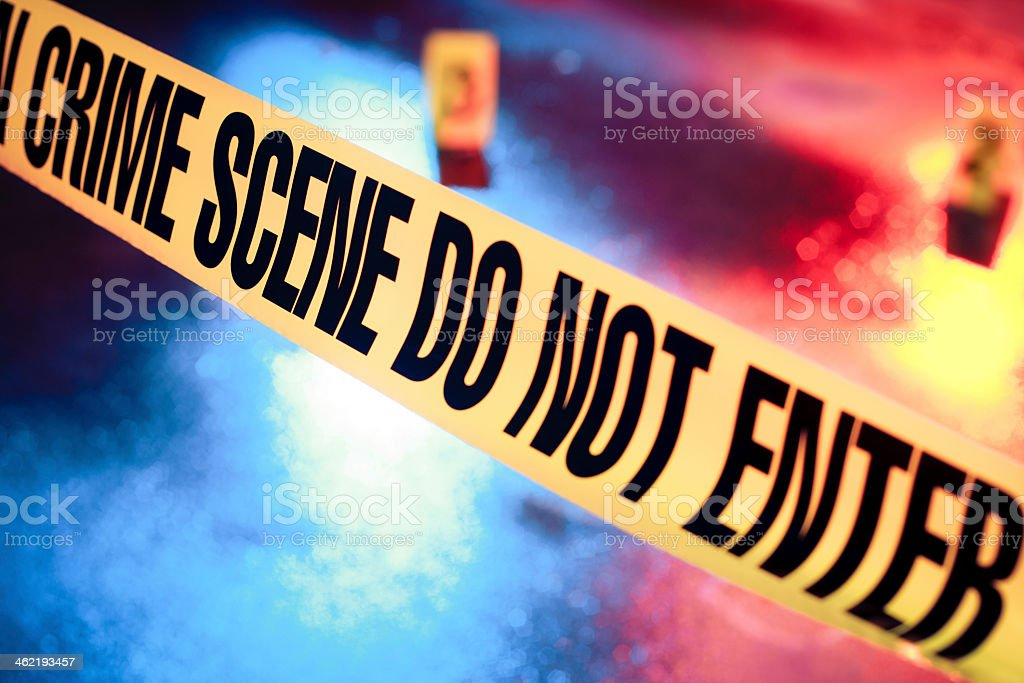 Photo of a fresh crime scene with caution tape stock photo