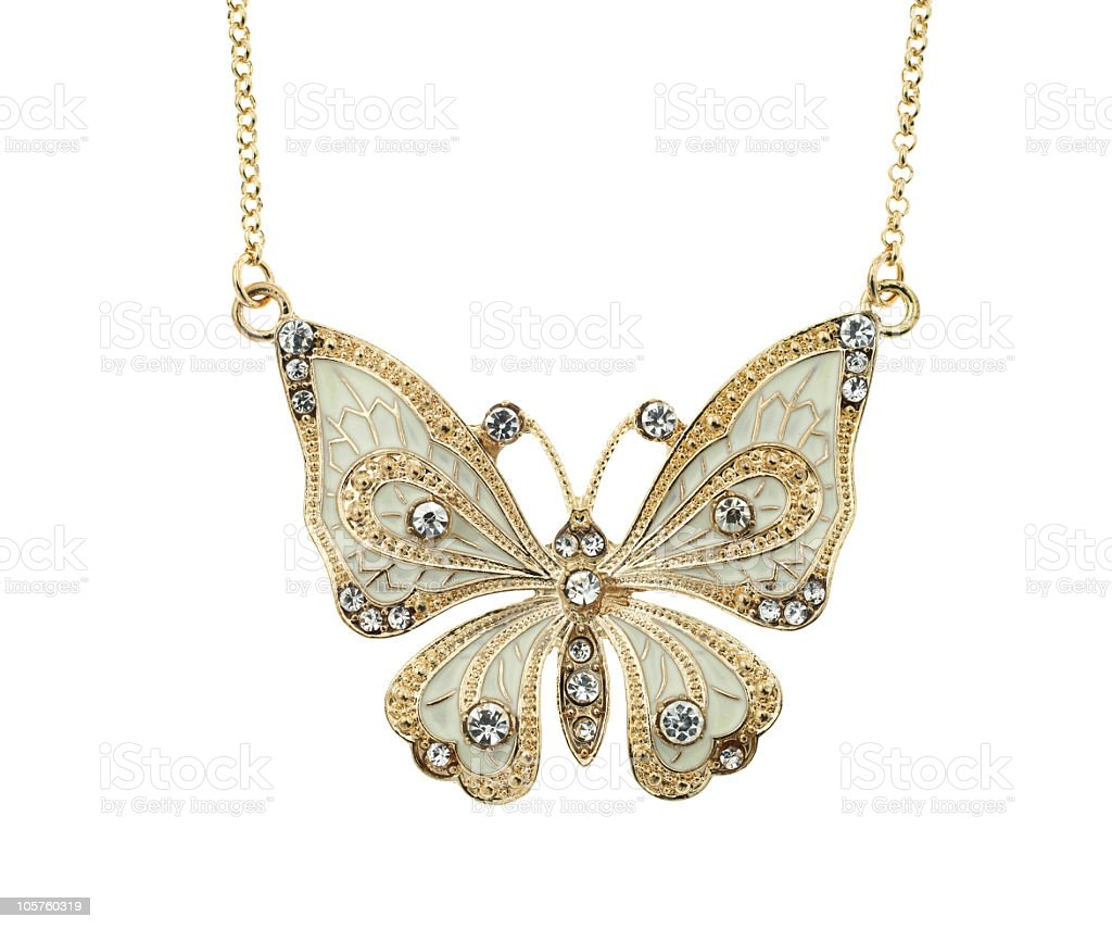 Photo of a golden butterfly necklace on a white background royalty-free stock photo