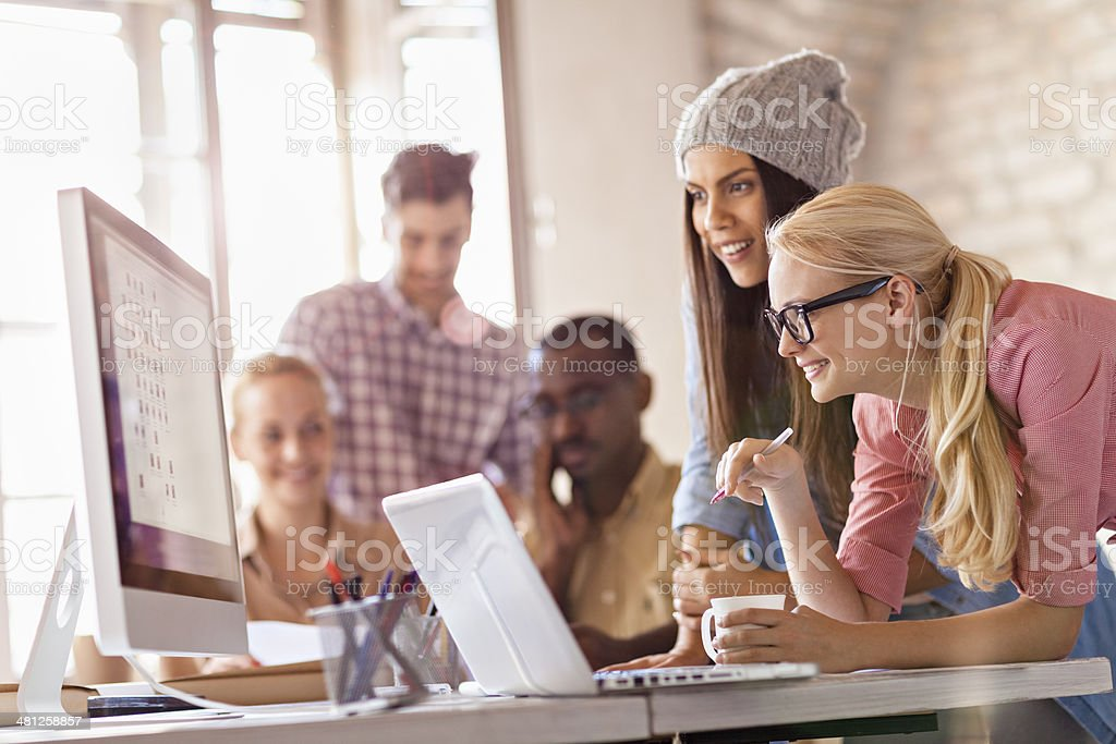 Photo of a group of designers working together stock photo