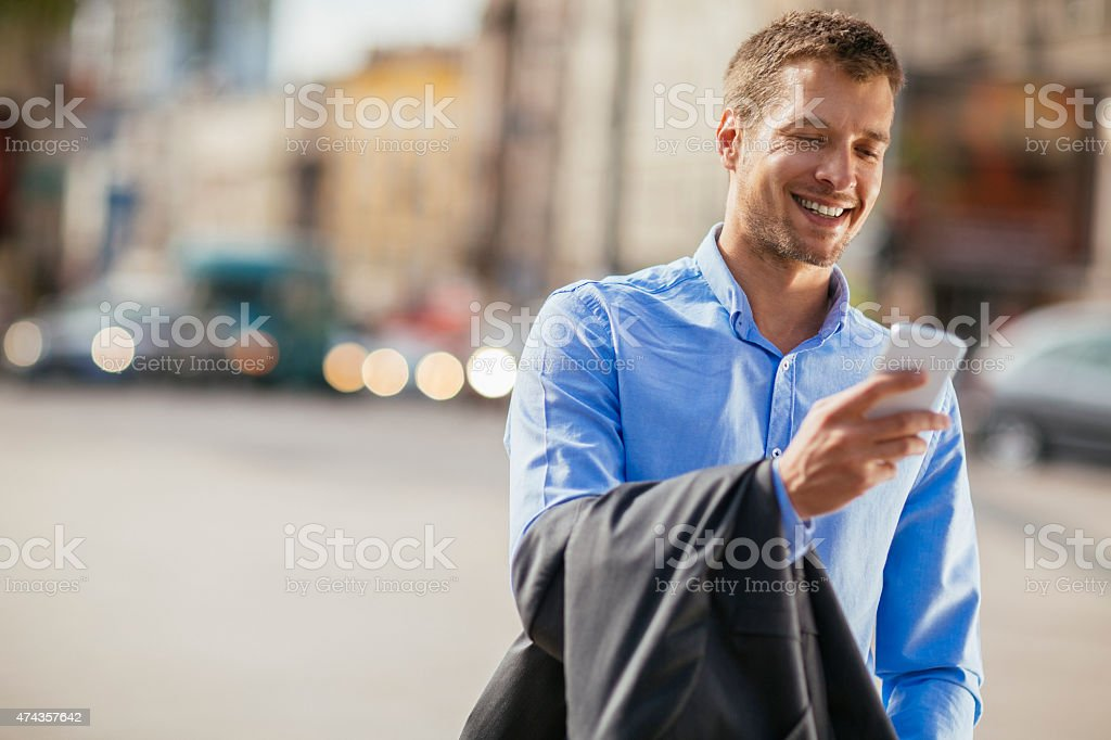 Photo of a handsome businessman using smart phone stock photo