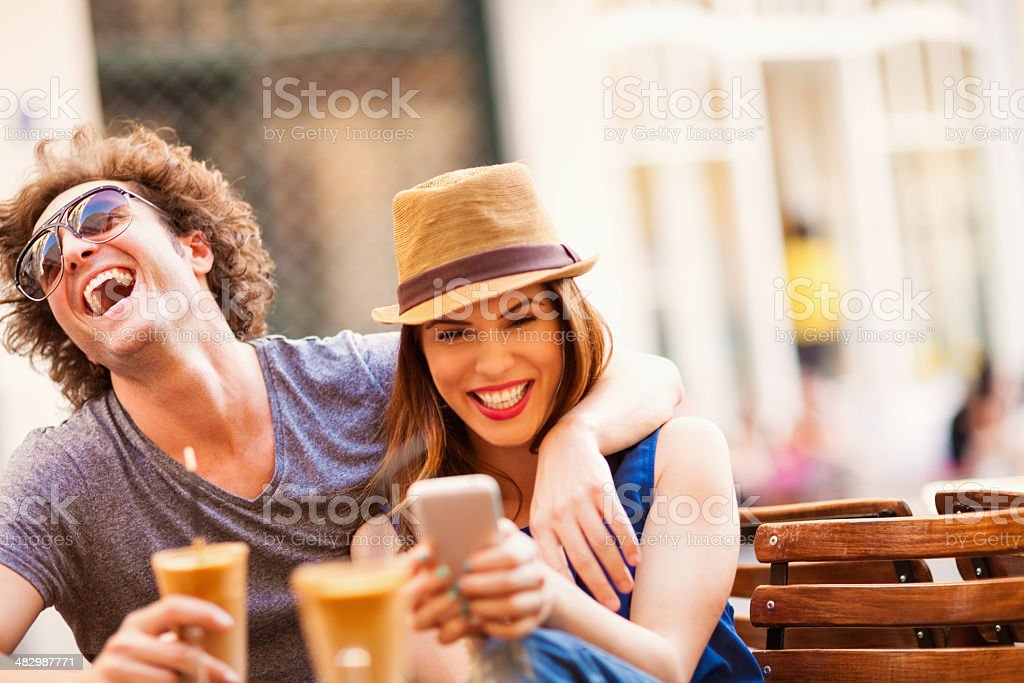 Photo of a happy couple  looking at mobile phone stock photo
