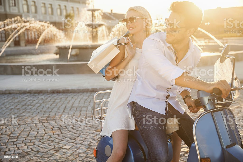 Photo of a happy couple on vintage scooter stock photo