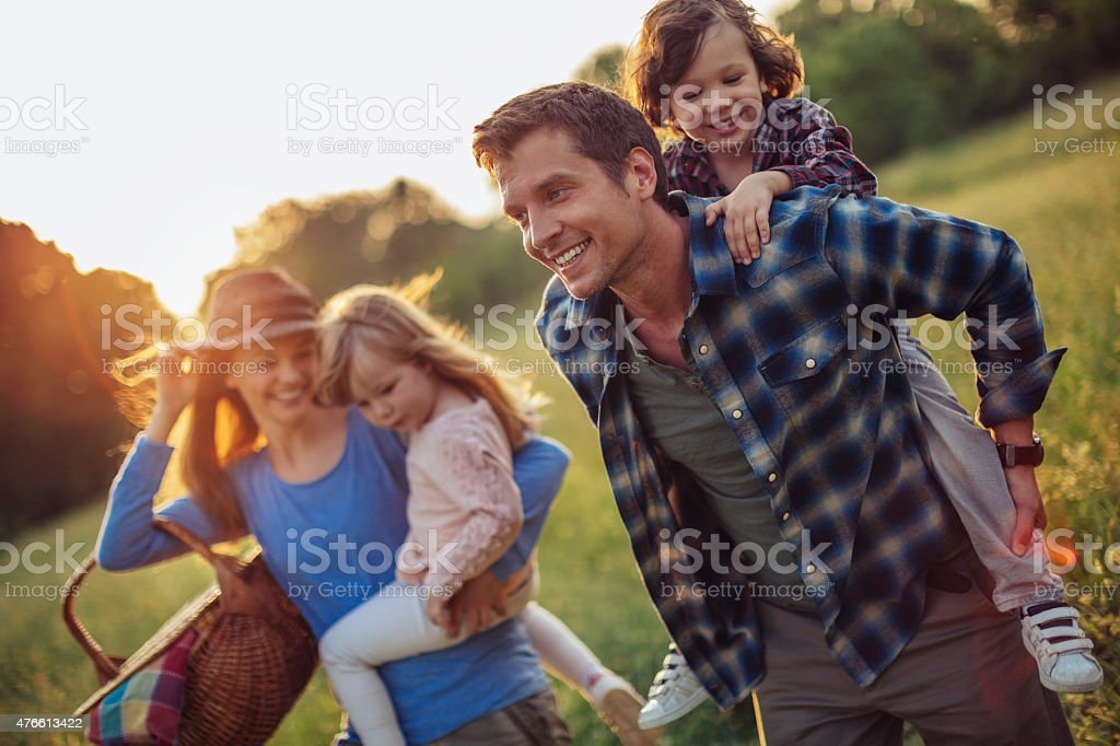 Photo of a happy family going for picnic stock photo