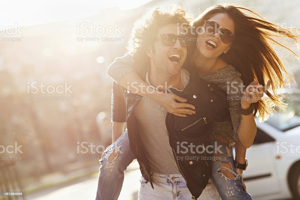 Photo of a happy laughing young couple in city stock photo
