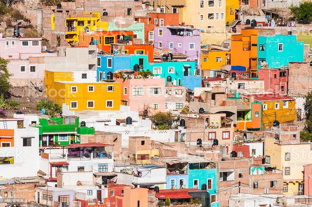 Photo of a hillside Mexican town and its colorful structures stock photo