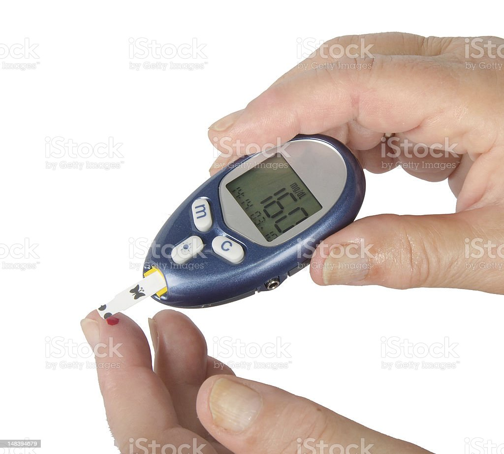 Photo of a home glucose meter pricking a drop of blood royalty-free stock photo