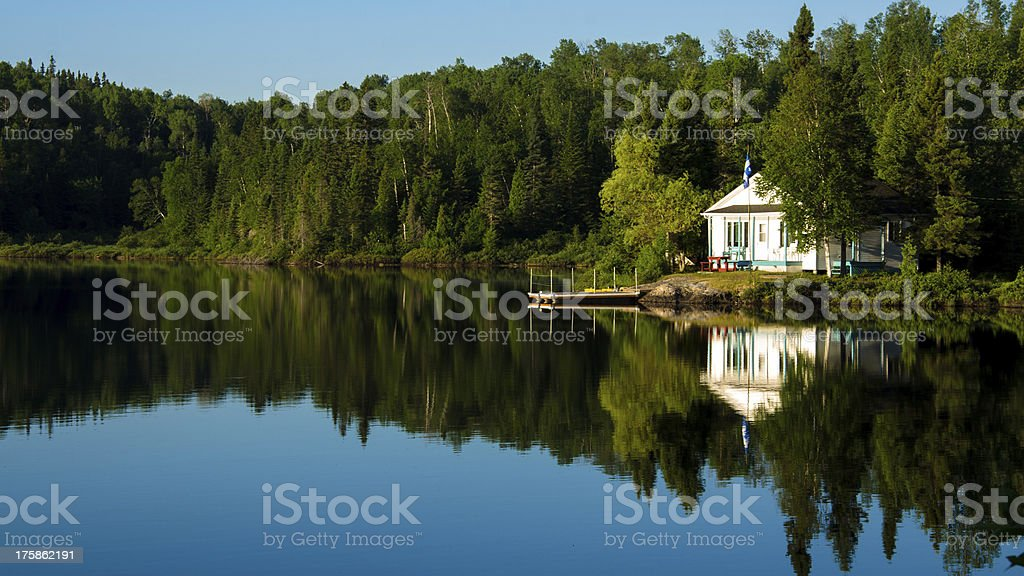 Photo of a house right next to a lake stock photo