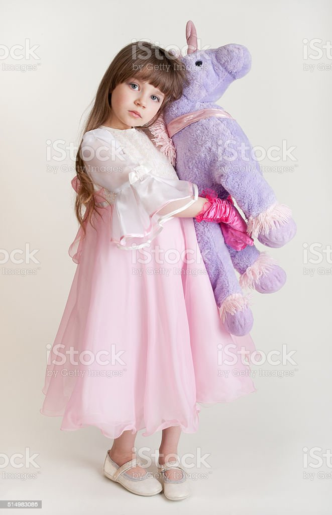 photo of a little girl with a soft toy stock photo
