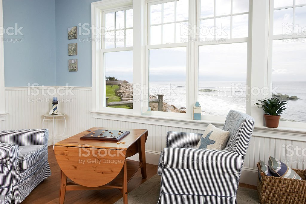 Photo of a living room with an ocean view stock photo