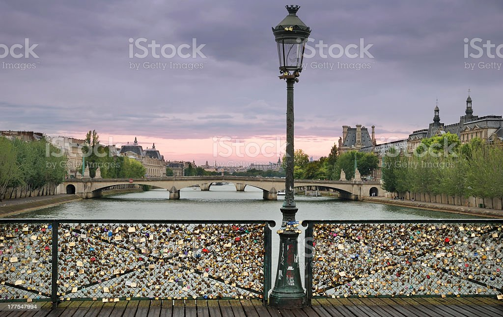A photo of a love padlock bridge stock photo