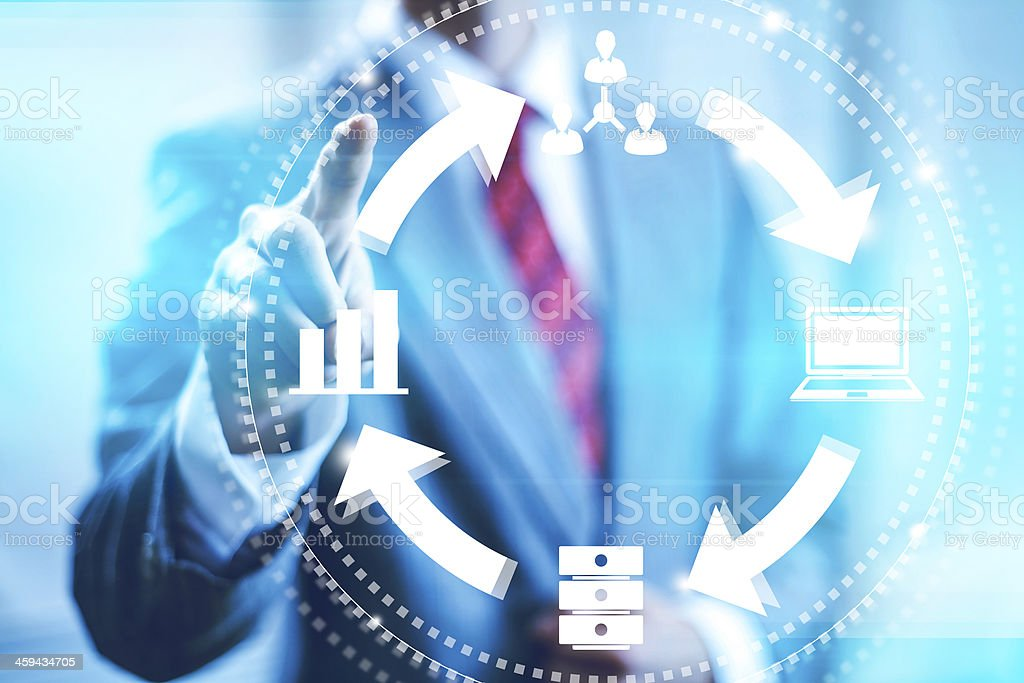 Photo of a man selecting online business cycle stock photo