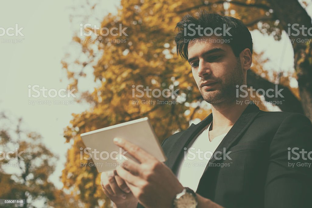 Photo of a man typing text message stock photo