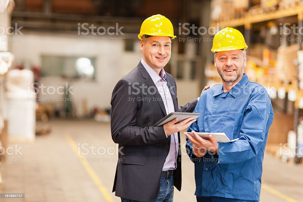 Photo of a manager and worker in warehouse stock photo