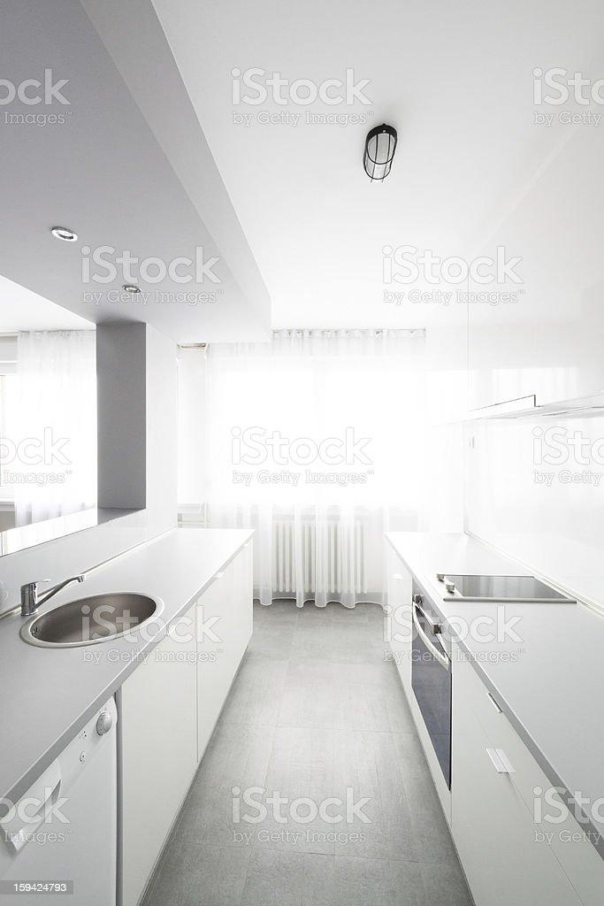 Photo of a modern minimalist white kitchen royalty-free stock photo