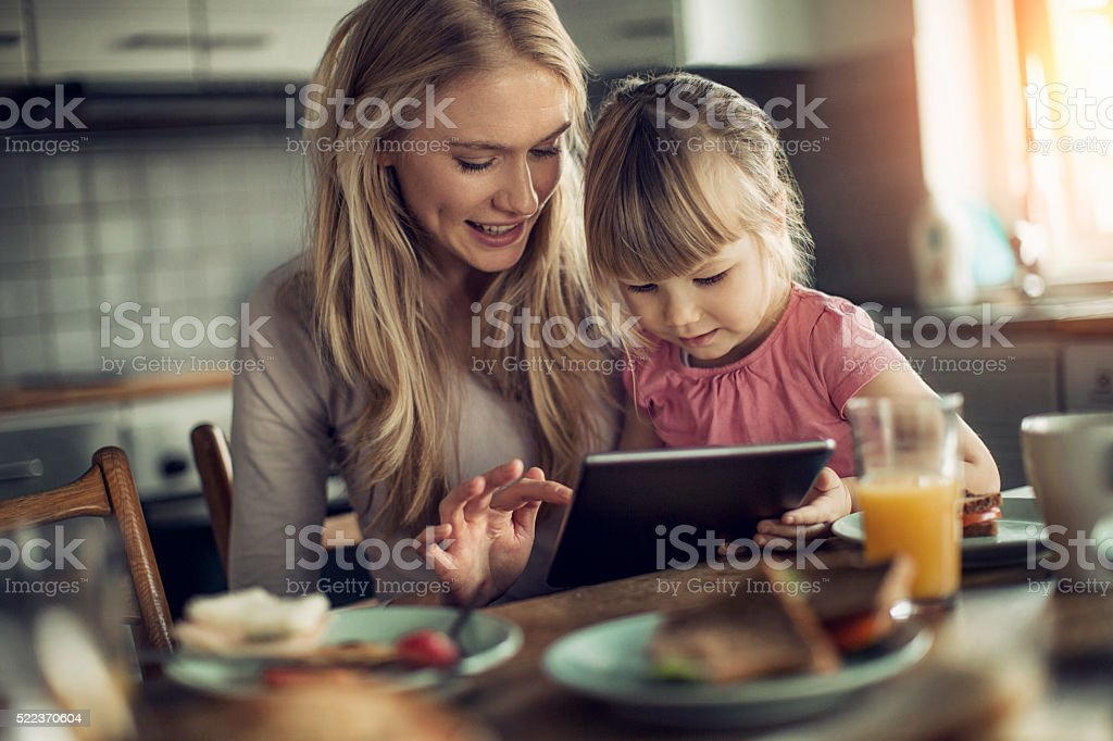 Photo of a mother and daughter having breakfast stock photo