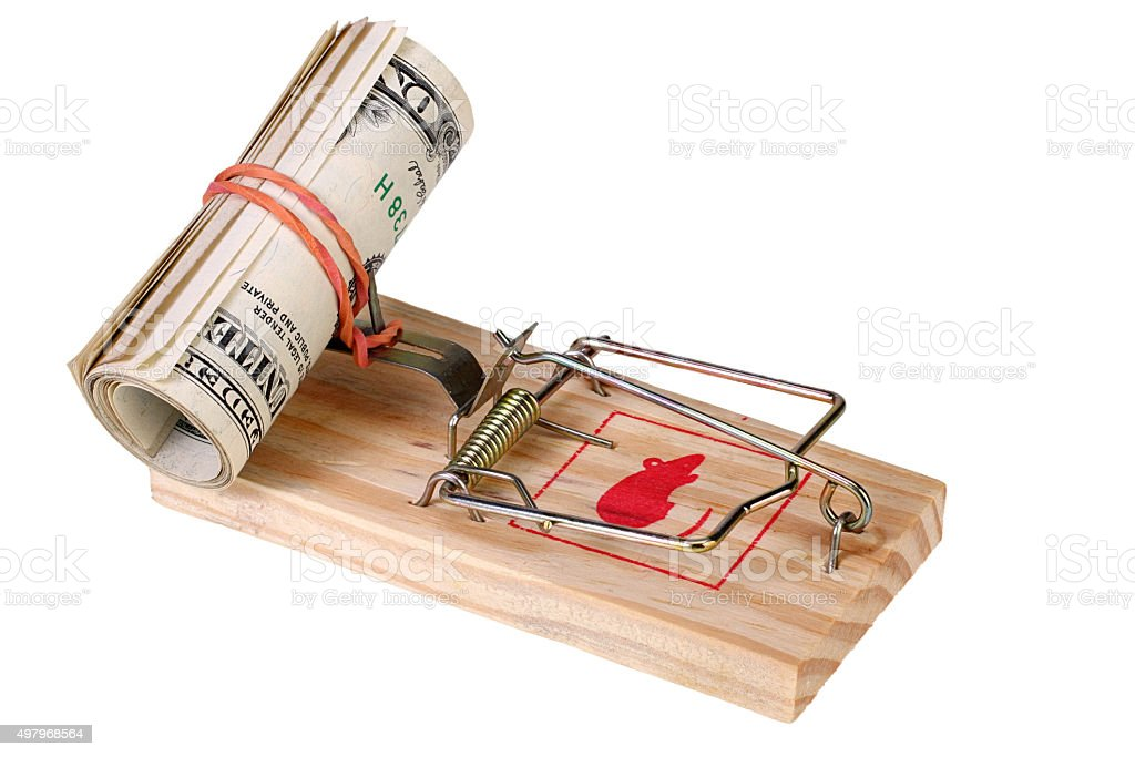 Photo of a mouse trap with money as bait, concept stock photo