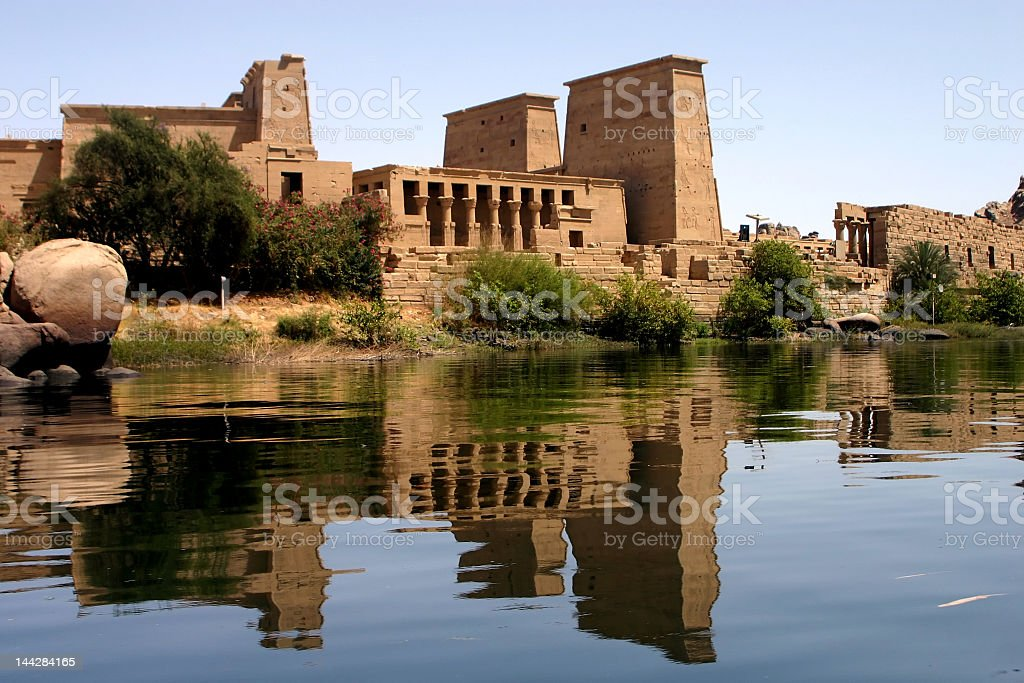 Photo of a Philae temple next to a body of water stock photo