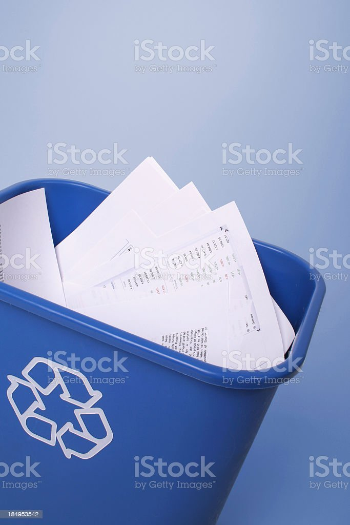 Photo of a recycling bin with papers royalty-free stock photo