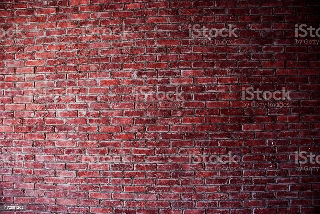 Photo of a rustic, bare, red brick wall, no subjects present royalty-free stock photo