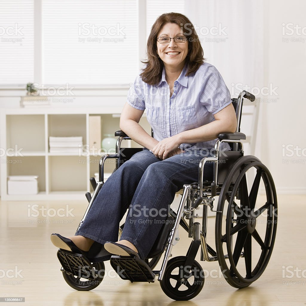 Photo of a smiling woman sitting in a wheelchair stock photo