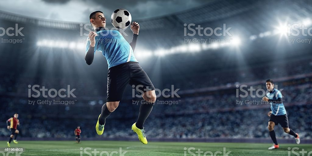 Photo of a soccer player playing a ball off his chest royalty-free stock photo