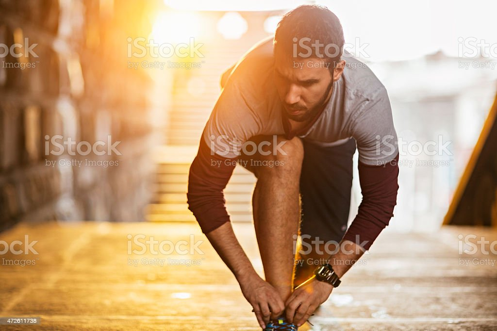 Photo of a young athletic man getting ready stock photo