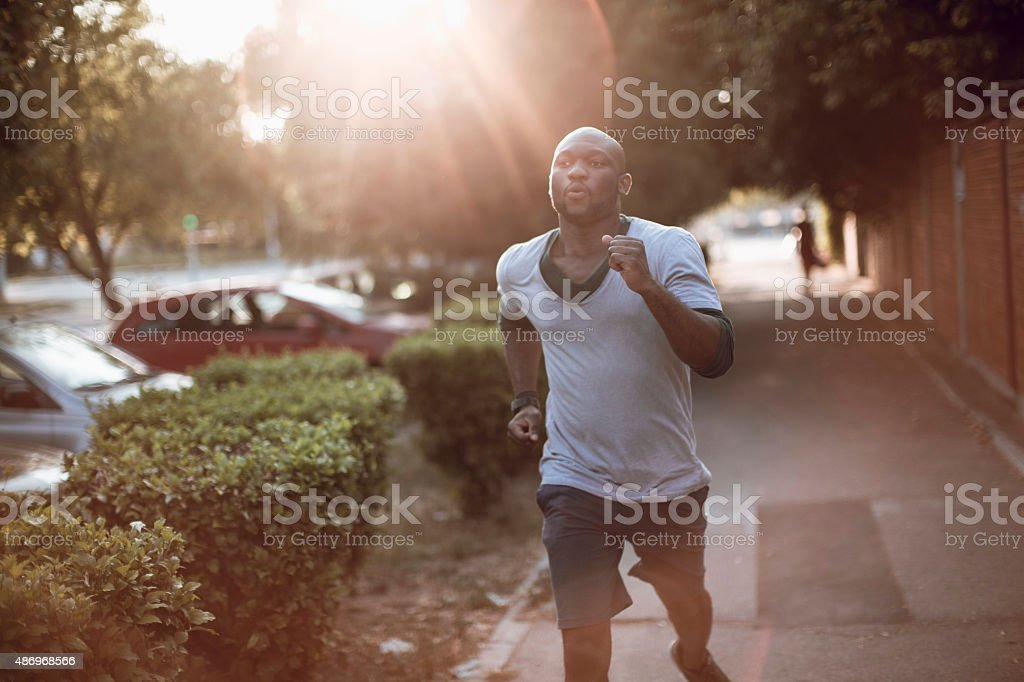 Photo of a young athletic man running stock photo