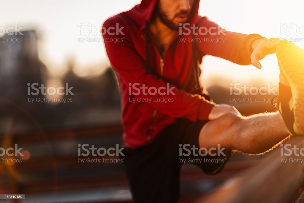 Photo of a young athletic man stretching stock photo