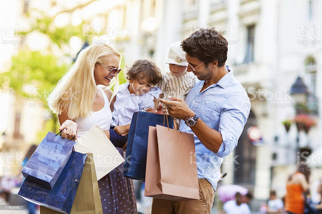 Photo of a young beautiful family enjoying shopping royalty-free stock photo