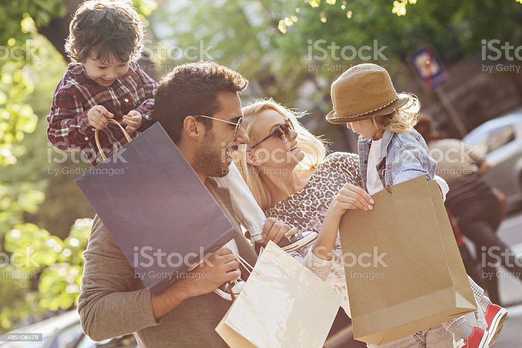 Photo of a young beautiful family enjoying shopping stock photo