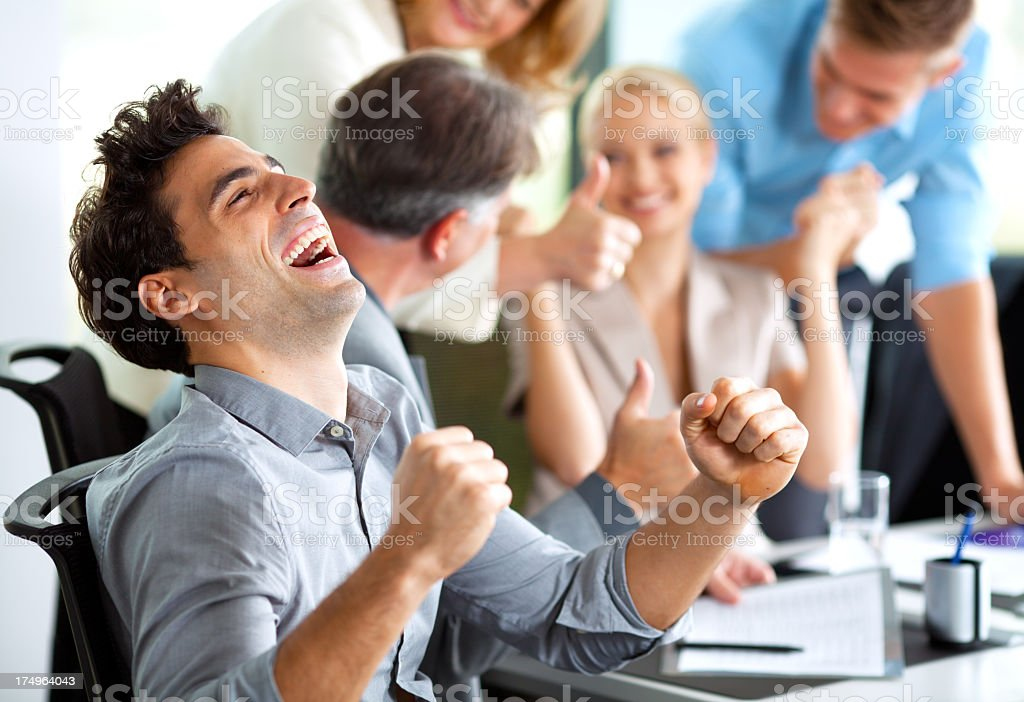 Photo of a young businessman celebrating success royalty-free stock photo