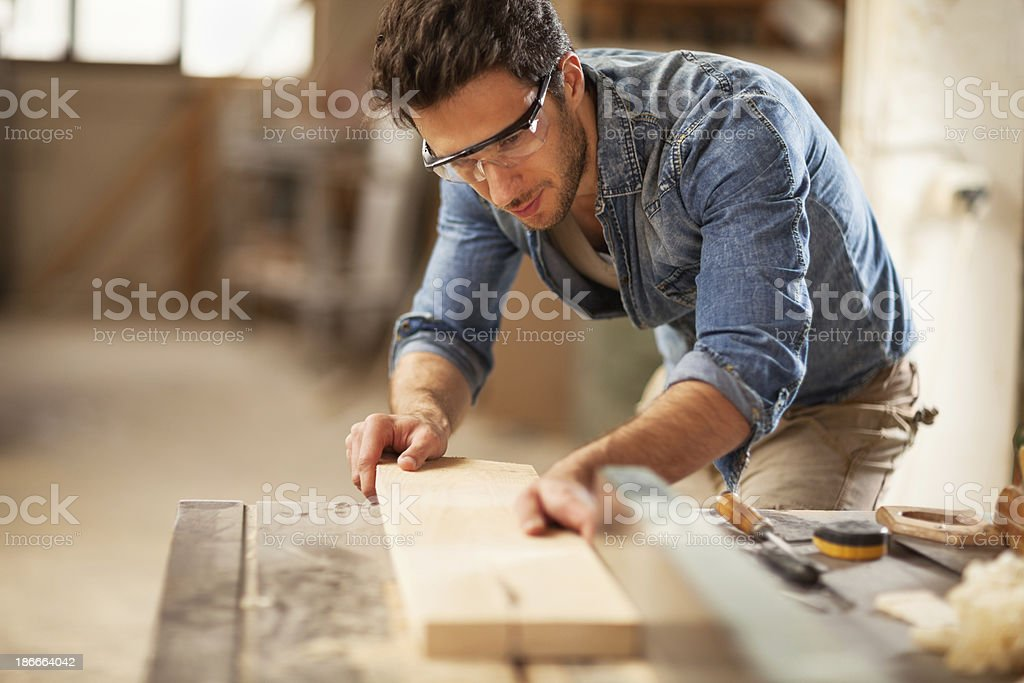 Photo of a young carpenter at work stock photo