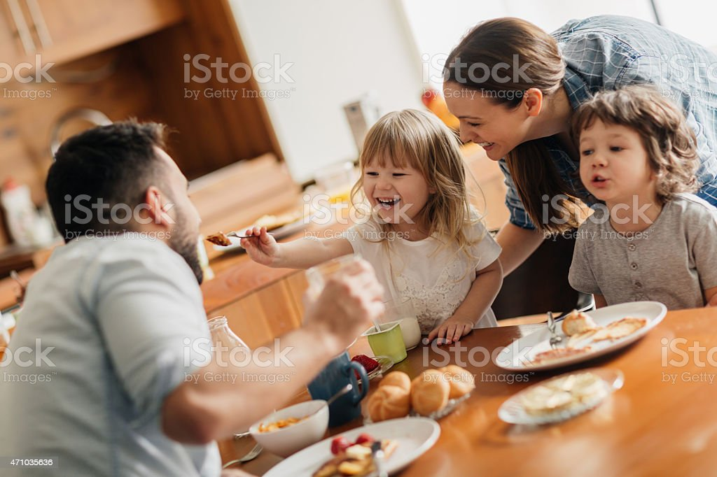 Photo of a young family having breakfast together stock photo