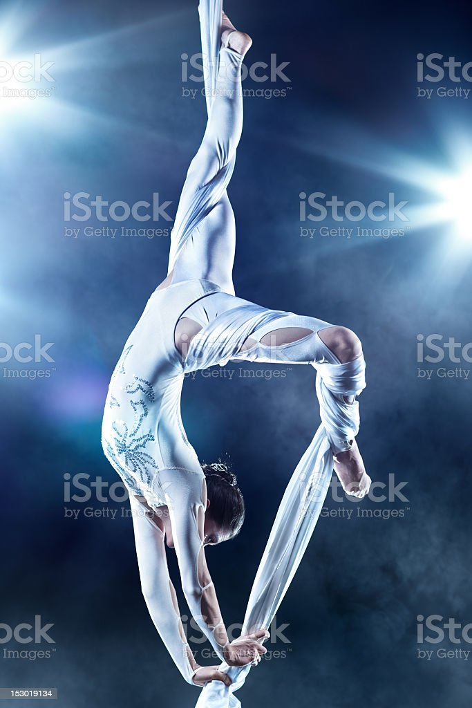 Photo of a young female gymnast demonstrating vast strength stock photo