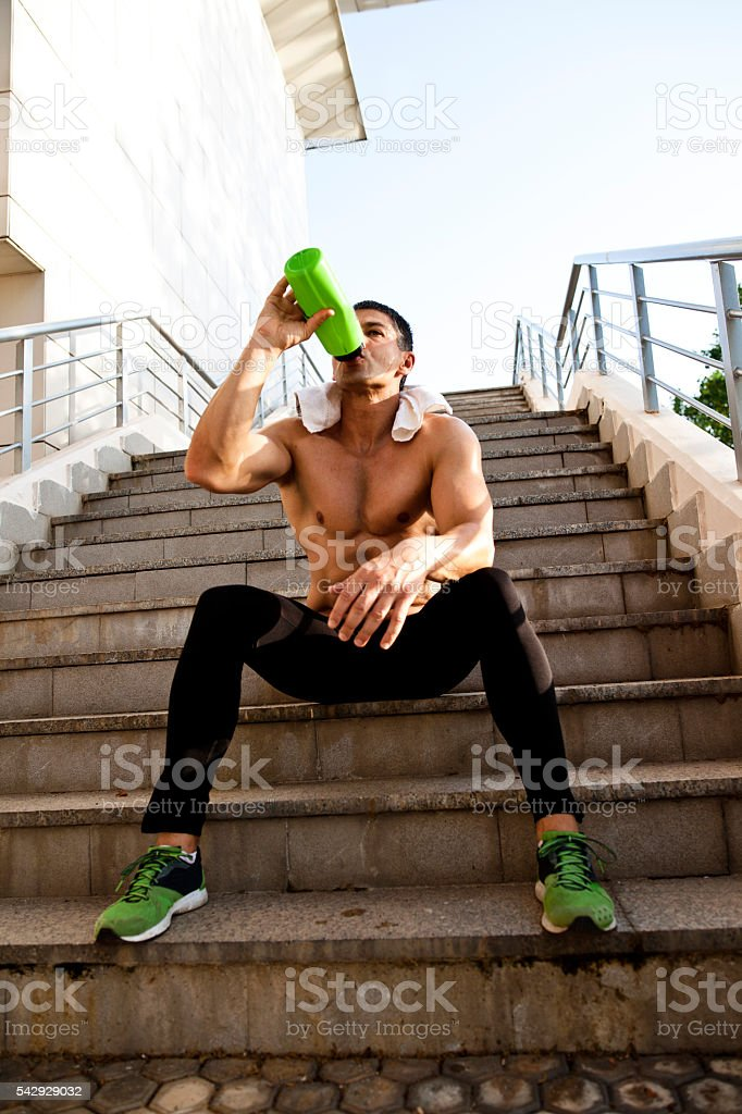Photo of a young man drinking water stock photo