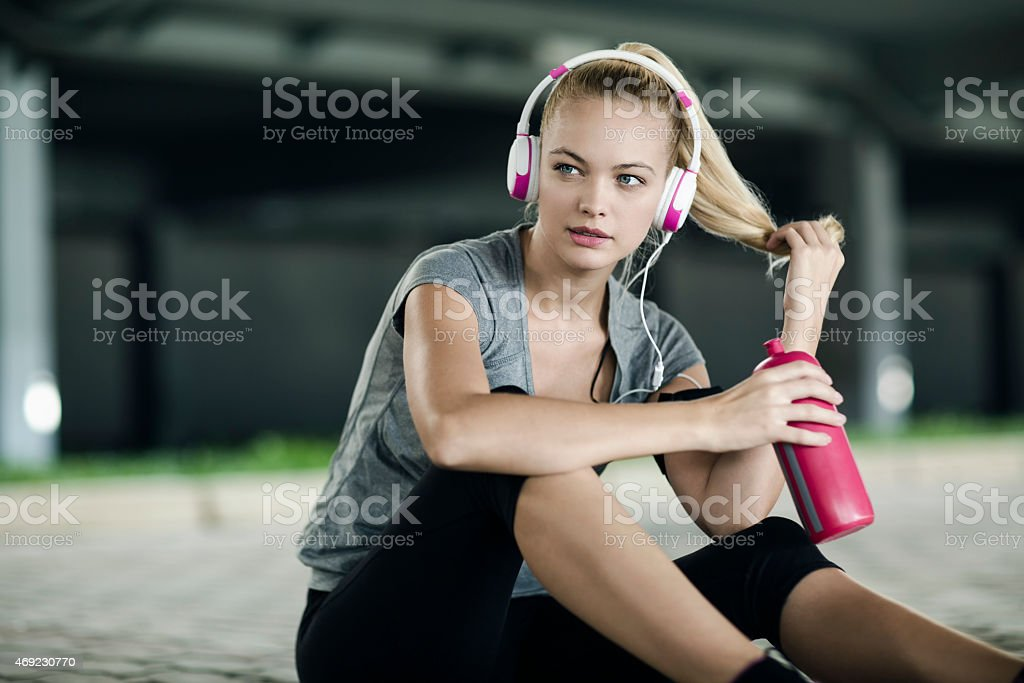 Photo of a young woman having break from exercise stock photo