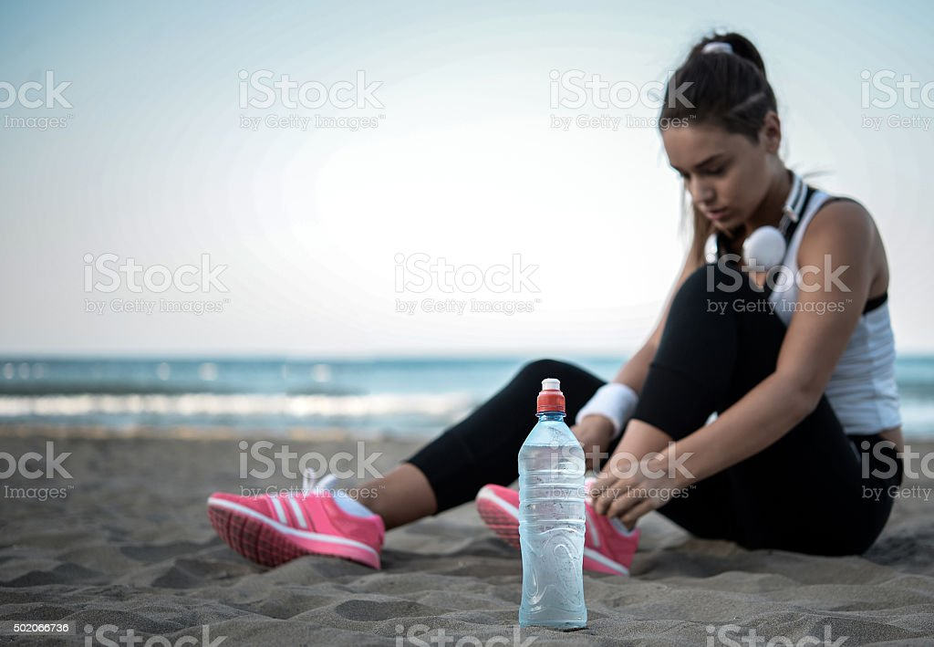 Photo of a young woman having break from exercise. stock photo