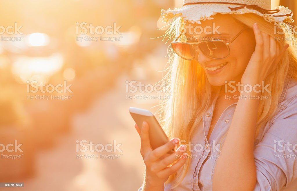 Photo of a young woman looking at smartphone in city royalty-free stock photo