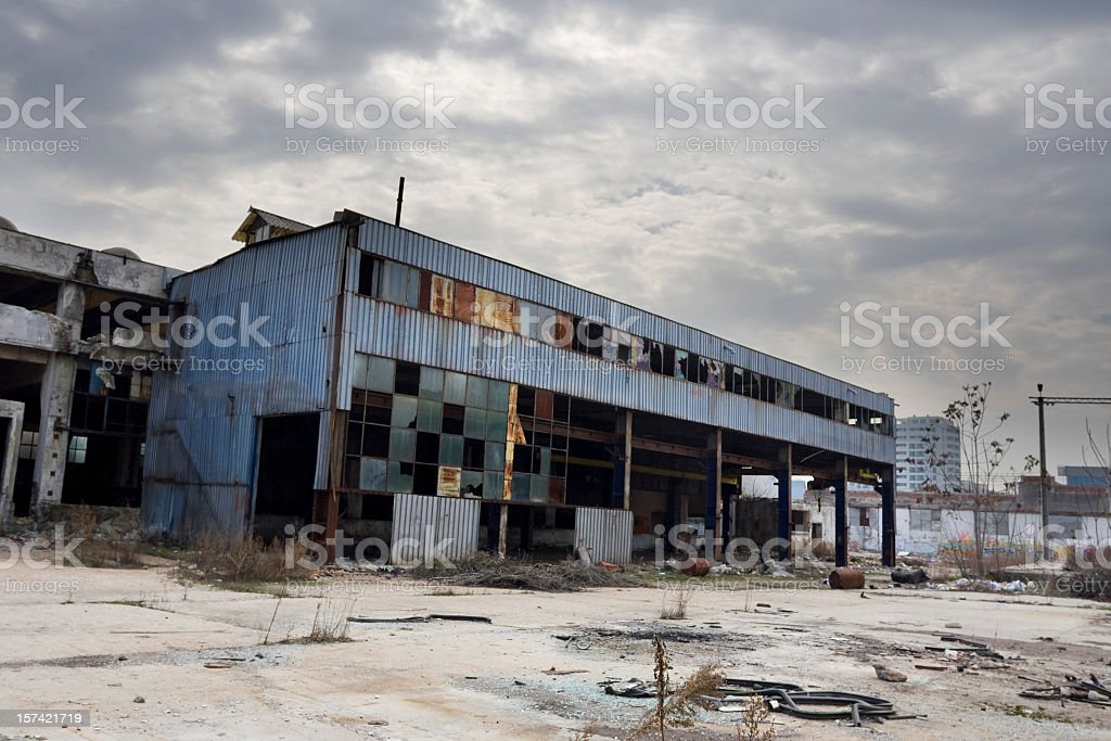Photo of an abandoned industrial building with broken window royalty-free stock photo