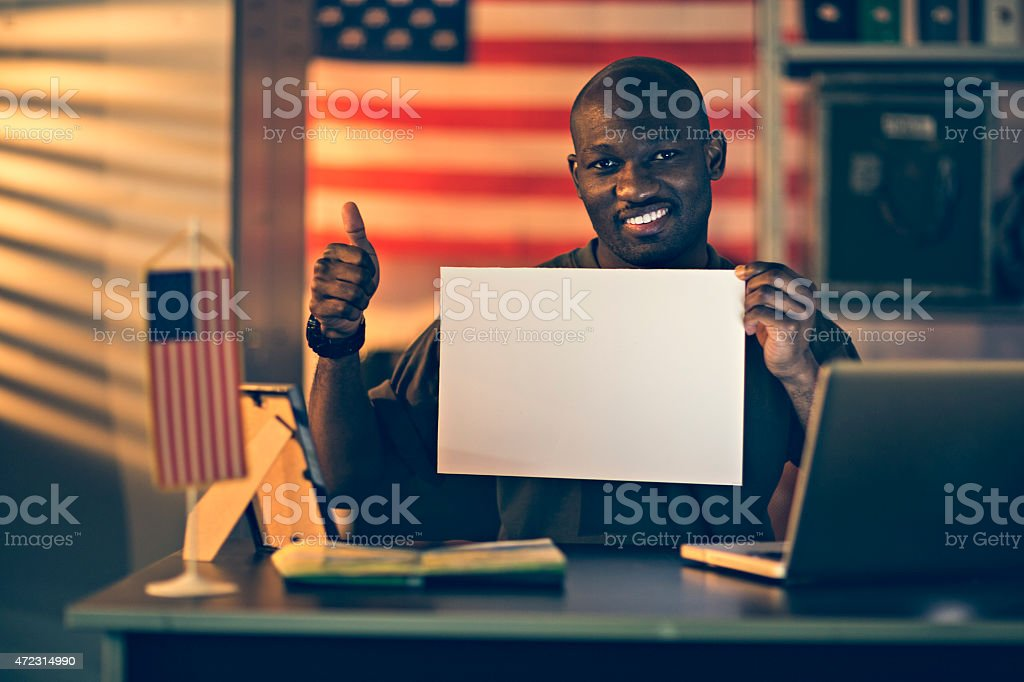 Photo of an american soldier holding a sign stock photo