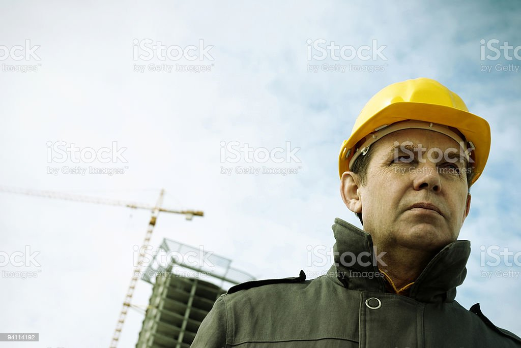 Photo of an architect wearing a hard hat at the job site royalty-free stock photo