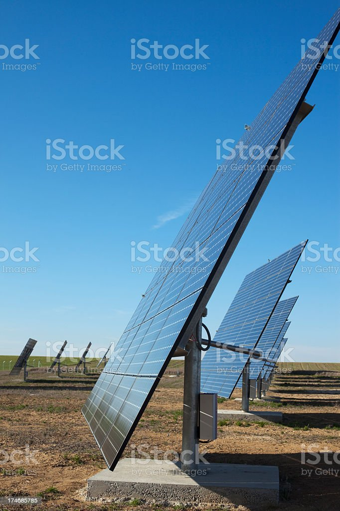 Photo of an arrangement of solar panels at a power station royalty-free stock photo