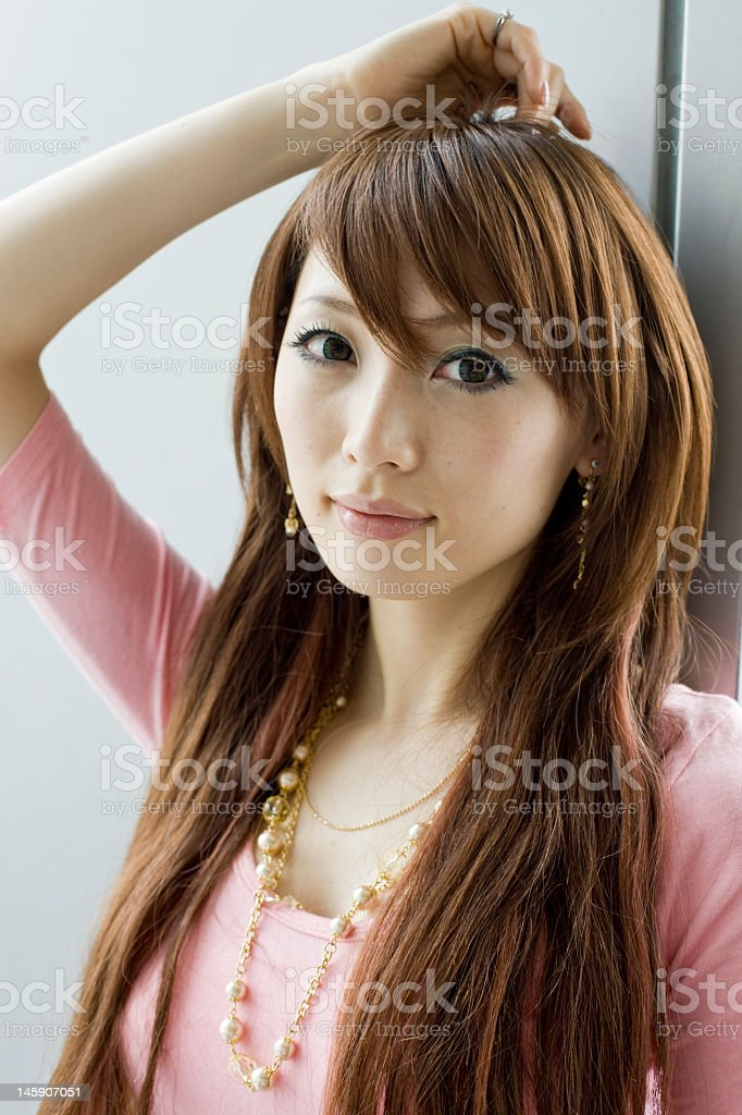 A photo of an Asian woman, chest-up, in a pink top royalty-free stock photo