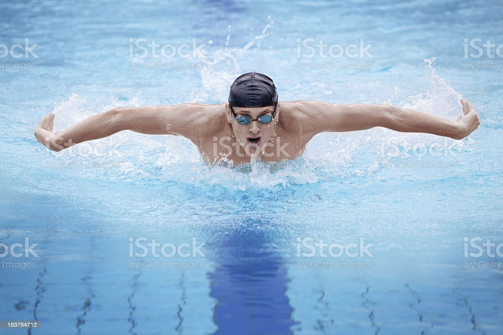Photo of an athlete swimmer performing the butterfly stroke stock photo