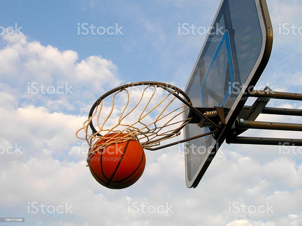 Photo of basketball flying through the hoop stock photo
