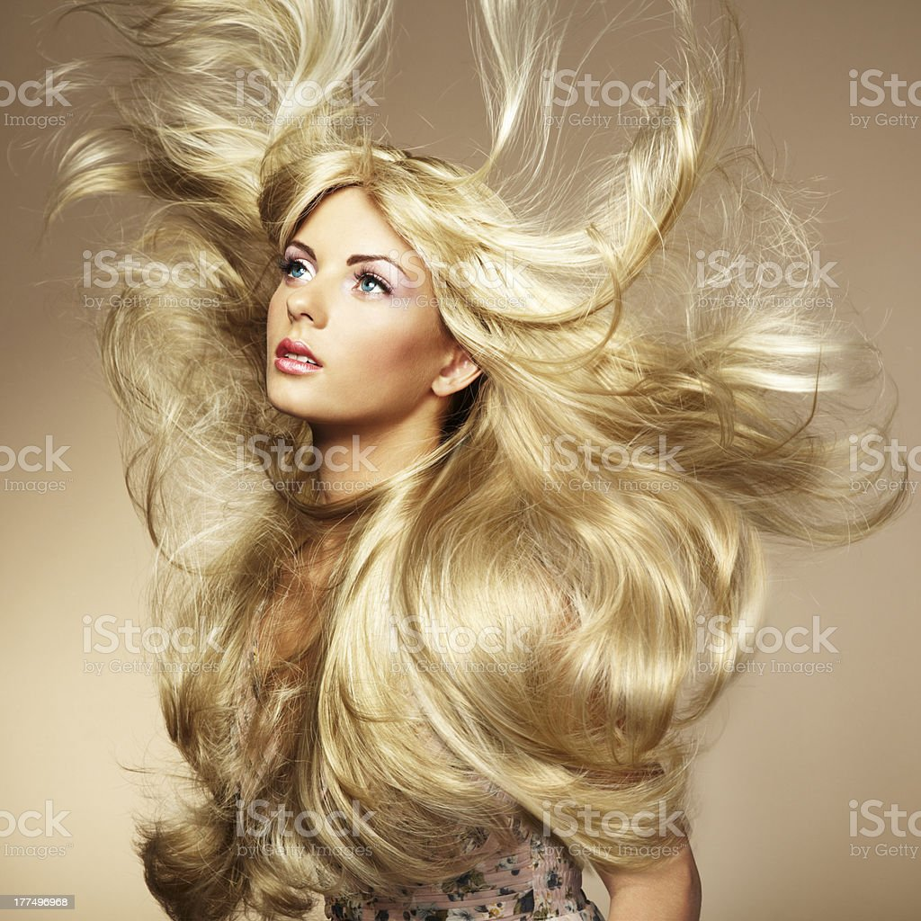 Photo of beautiful woman with magnificent hair royalty-free stock photo